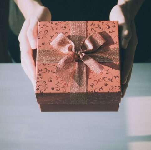 person giving a gift